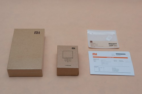 Redmi Smartphone, UK Power Adapter, SIM card sleeve, Packing list
