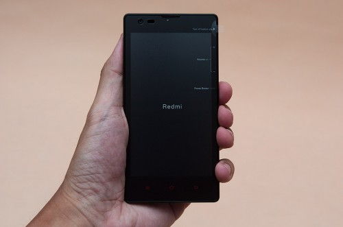 Xiaomi Redmi phone with a protective screen cover to be removed on use
