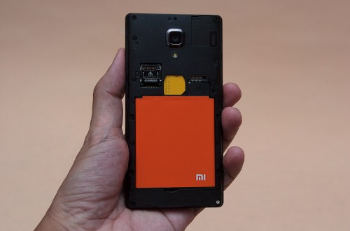 Loading in a 3G SIM card and the Lithium-ion battery to test the Redmi