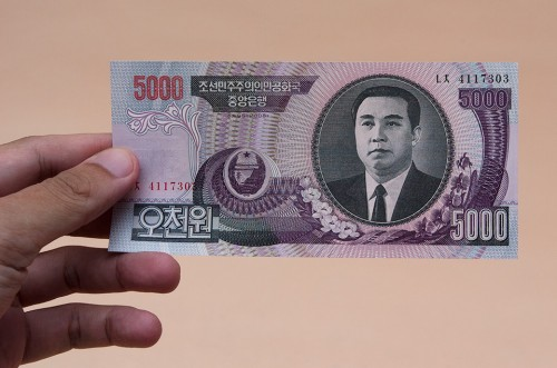 A printed note stating 5000 Korean Won